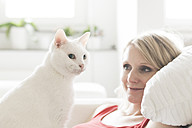 White cat and owner at home - CHPF00446