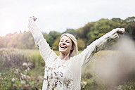 Portrait of happy blond woman outdoors - MOEF00246
