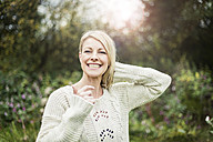 Portrait of happy blond woman outdoors - MOEF00249