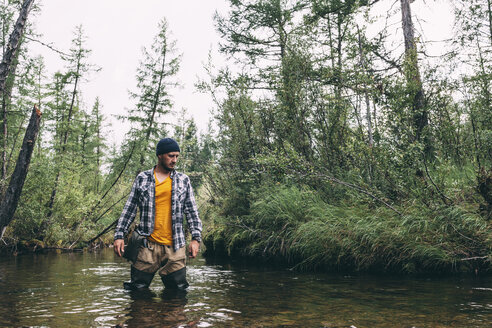 Man standing in river with waders - VPIF00238