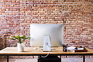 Workspace with brick wall in office - HAPF02334