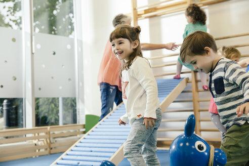 Happy children in gym room in kindergarten - MFF04051
