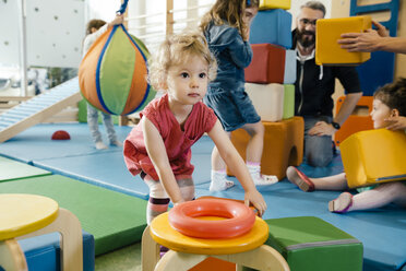 Little girl playing in gym room of a kindergarten - MFF04060