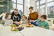 Children and teachers preparing fruit in kindergarten - MFF04069