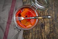 Pickled roasted bell pepper, open preserving jar and fork - LVF06397