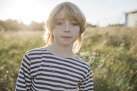 Portrait of blond boy at backlight - KMKF00056