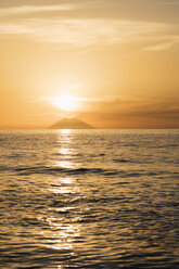Italy, Calabria, Tropea, Tyrrhenian Sea, View to volcanic island Stromboli against the sun - CSTF01466