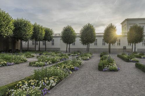 Germany, Lower Saxony, Hanover, Herrenhaeuser Gaerten, flower garden in the evening - PVCF01168