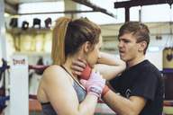 Female martial artist sparring with coach - FRF00604
