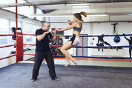 Female martial artist sparring with coach - FRF00607