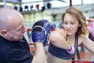 Female martial artist sparring with coach - FRF00610