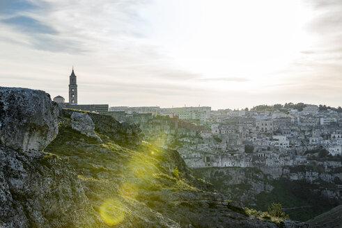 Italy, Basilicata, Matera, townscape against the sun - CSTF01467