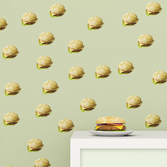 Plate with Hamburger on cup board in front of wallpaper with Hamburger pattern, 3D Rendering - UWF01297