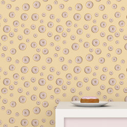 Plate with doughnut on cup board in front of wallpaper with doughnut pattern, 3D Rendering - UWF01306