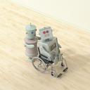 Female robot pushing male robot sitting in wheelchair, 3D rendering - UWF01321
