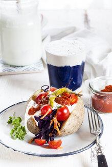 Kumpir, Turkish baked potato with raw vegetable salad, carrot, tomato, yogurt sauce, ajvar and Ayran - SBDF03348