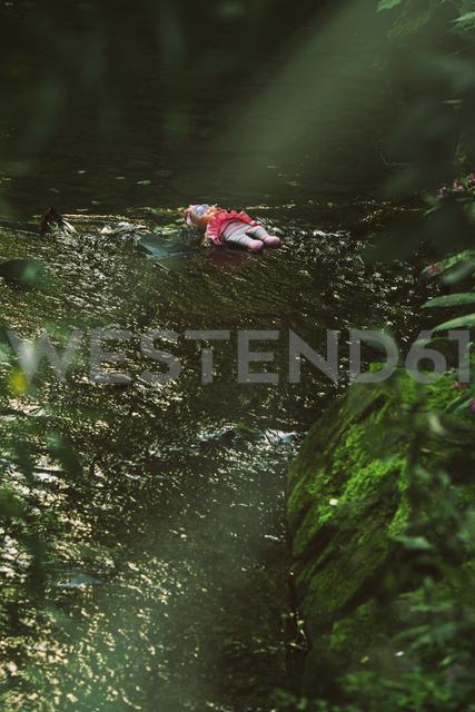 Doll lying in brook - REAF00263
