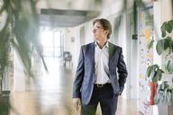 Businessman standing on office floor - JOSF01871