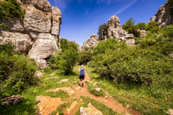 Spain, Malaga Province, El Torcal, woman hiking - SMAF00861