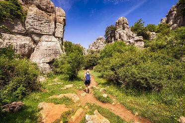 Spain, Malaga Province, El Torcal, woman hiking - SMAF00861