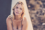 Spain, Tenerife, portrait of relaxed blond woman at sunset - SIPF01850