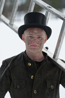 Germany, portrait of chimney sweep with ladder wearing top hat - LBF01703