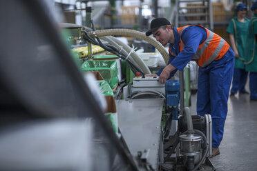 Man working on machine in factory - ZEF14706