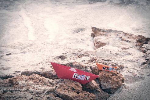 Two paper boats with the word 'Hope' on the beach - CMF00735