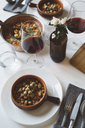 Laid table with Mediterranean soup and red wine - GIOF03303