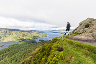 UK, Scotland, Highland, Trossachs, tourist looking from mountain Ben A'an to Loch Katrine - FOF09454