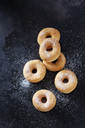 Six mini doughnuts sprinkled with sugar on dark ground - CSF28505