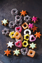 Jelly confectionery, coloured cinnamon stars and other Christmas cookies on dark ground - CSF28544