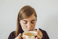Woman with hot cup of tea - JSCF00015