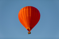 Red air balloon ageainst blue sky - KLR00545