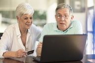 Senior couple shopping online with credit card - ZEF14743