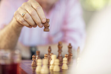 Close-up of senior couple playing chess - ZEF14758