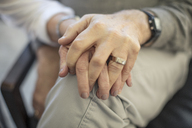 Close-up of senior couple holding hands - ZEF14770