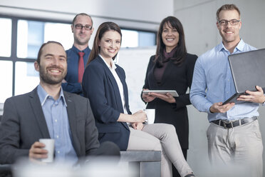 Portrait of smiling business team in office - ZEF14809