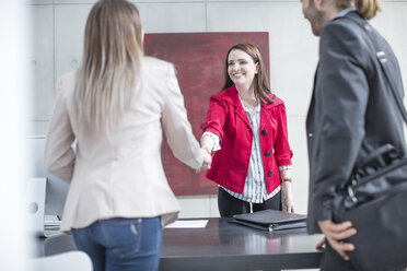 Business people shaking hands in office - ZEF14815