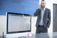 Businessman in office talking on the phone - ZEF14821