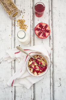 Breakfast with fruit muesli with pomegranate seed, bottle of milk and glass of pomegranate juice - LVF06415