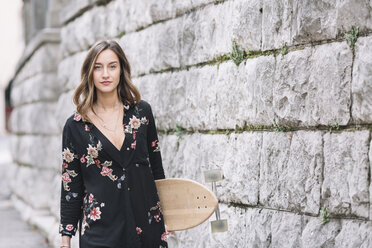 Portrait of fashionable woman with skateboard - ALBF00226