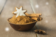 Bowl of cinnamon powder decorated with cinnamon star and cinnamon sticks - ODF01574