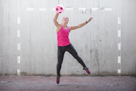 Woman jumping to catch a ball - ZEF14829