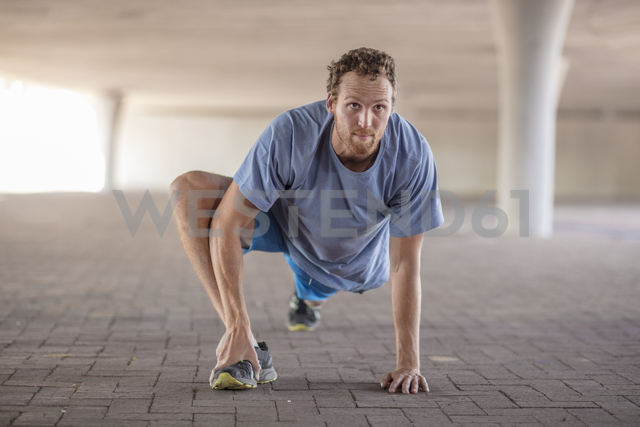 Sportive man stretching before exercising - ZEF14832