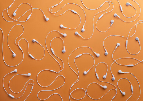 White earphones on orange background, 3D Rendering - DRBF00031