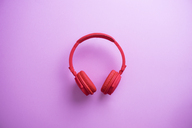 Wireless red headphones on pink background - DRBF00034