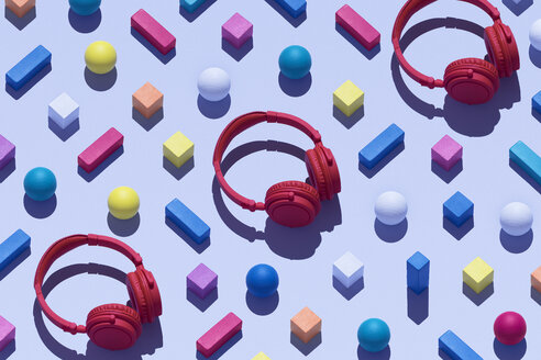 Three red wireless headphones surrounded by geometric shapes, 3D Rendering - DRBF00040