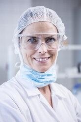 Portrait of smiling scientist in lab - WESTF23750