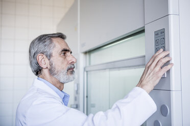 Scientist in lab handling security system - WESTF23771